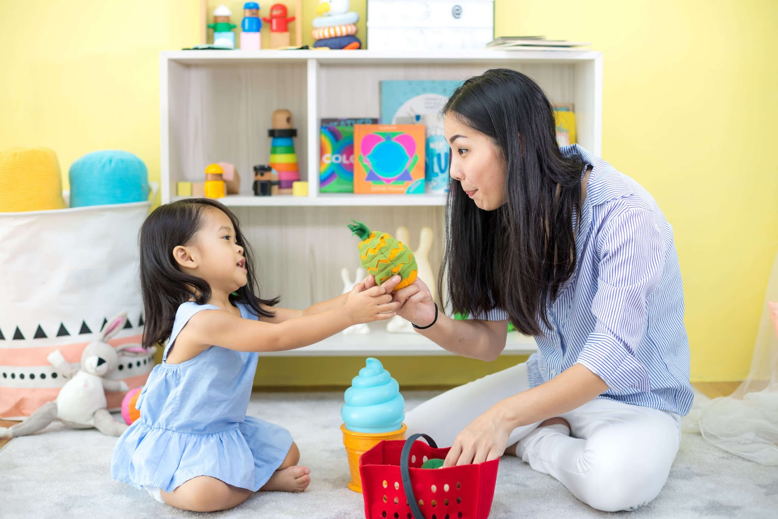 Woman and Child Playing with Plush Toy