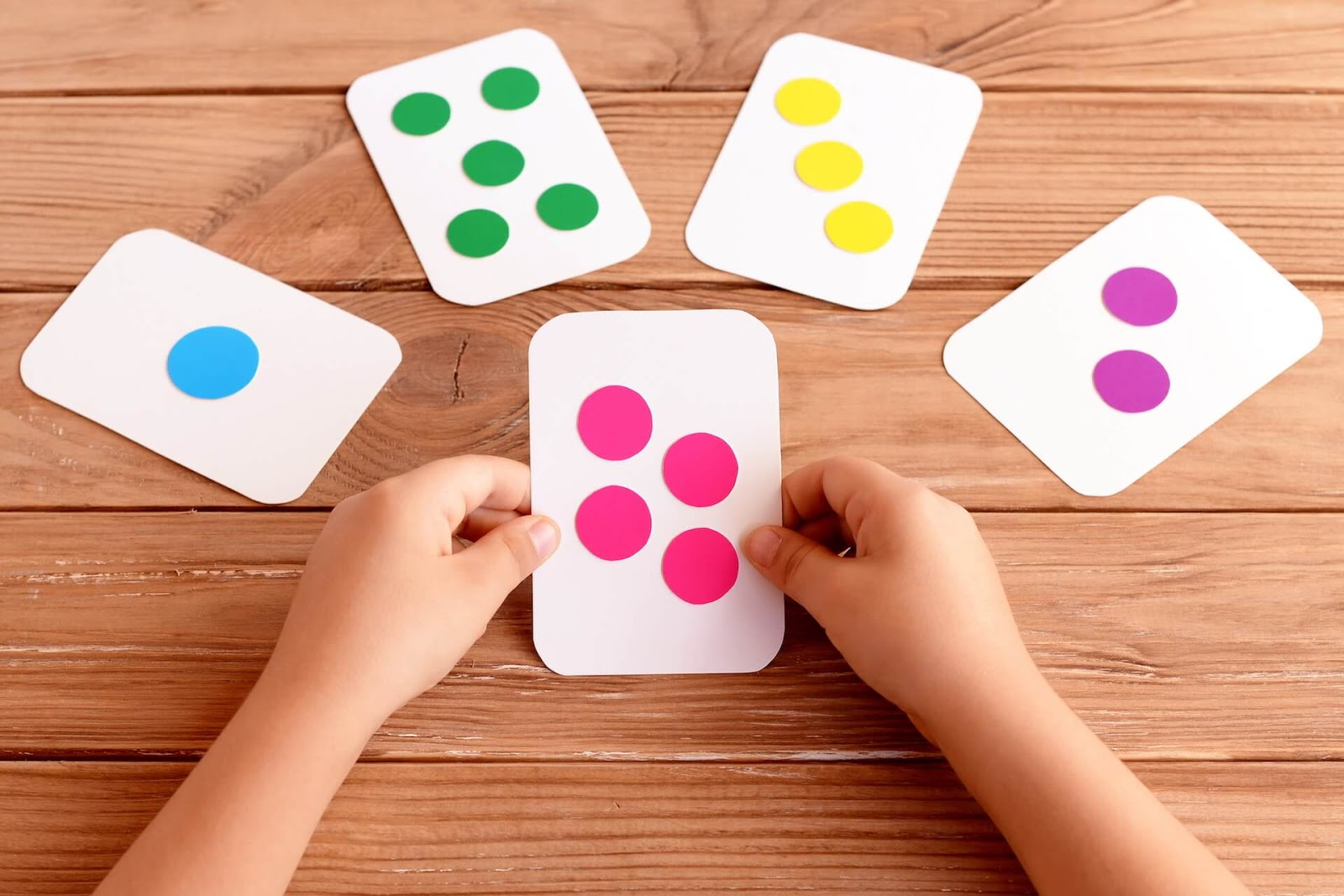 Child Playing with Number Cards