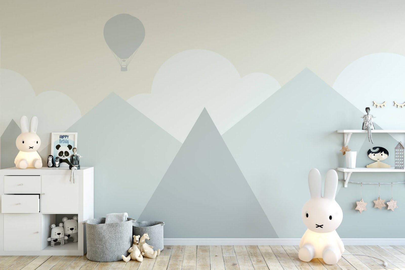 Nursery painted gray with mountains and clouds