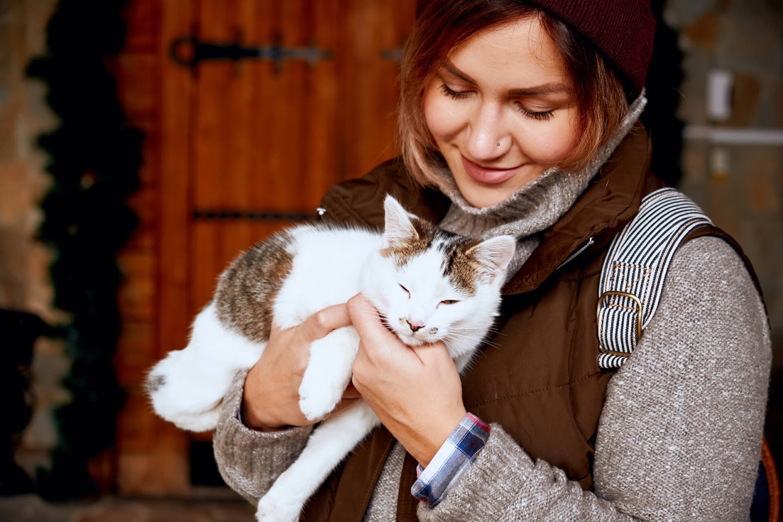 Woman volunteering and cuddling cats
