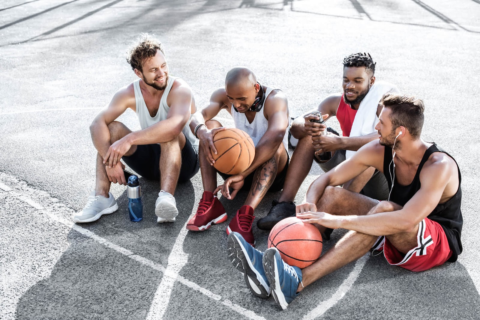 Group of guys resting after a basket ball game