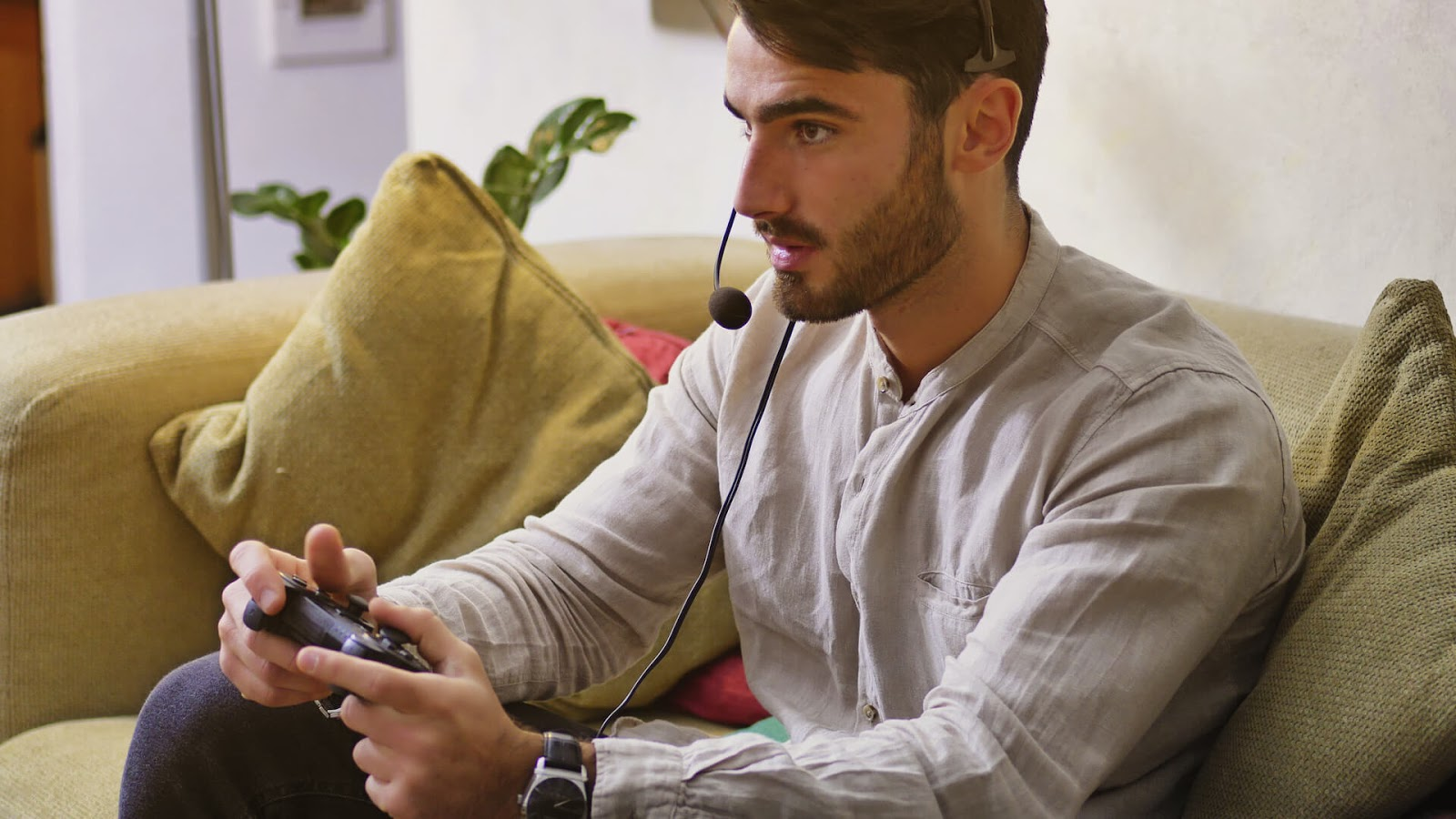 Man playing video game with headset on