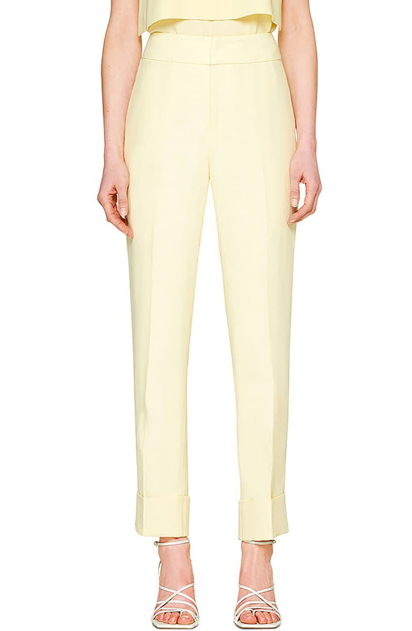 Woman in pastel yellow jumpsuit