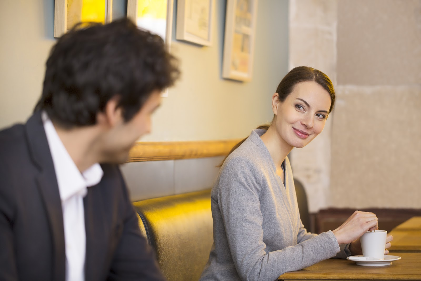 Woman and man smiling at each other in a restuarant