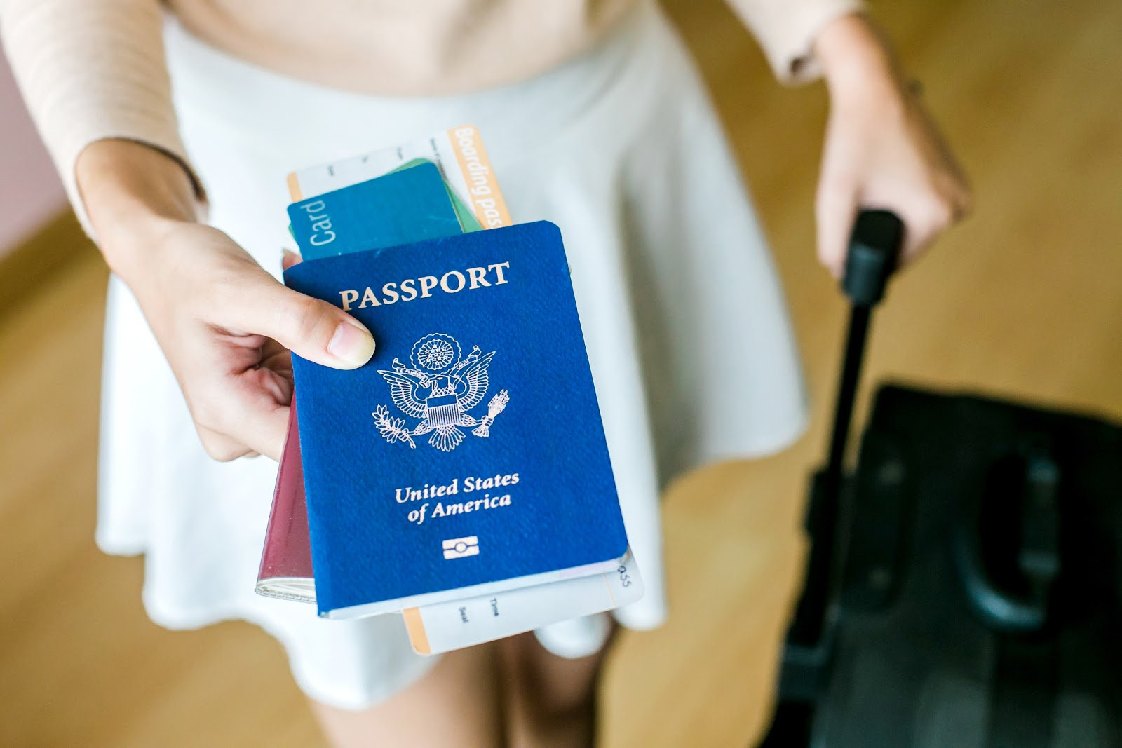 Woman holding out passport