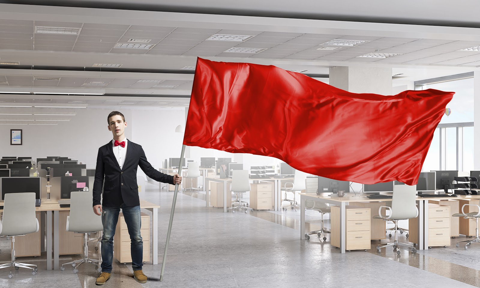 Man waving red flag in office