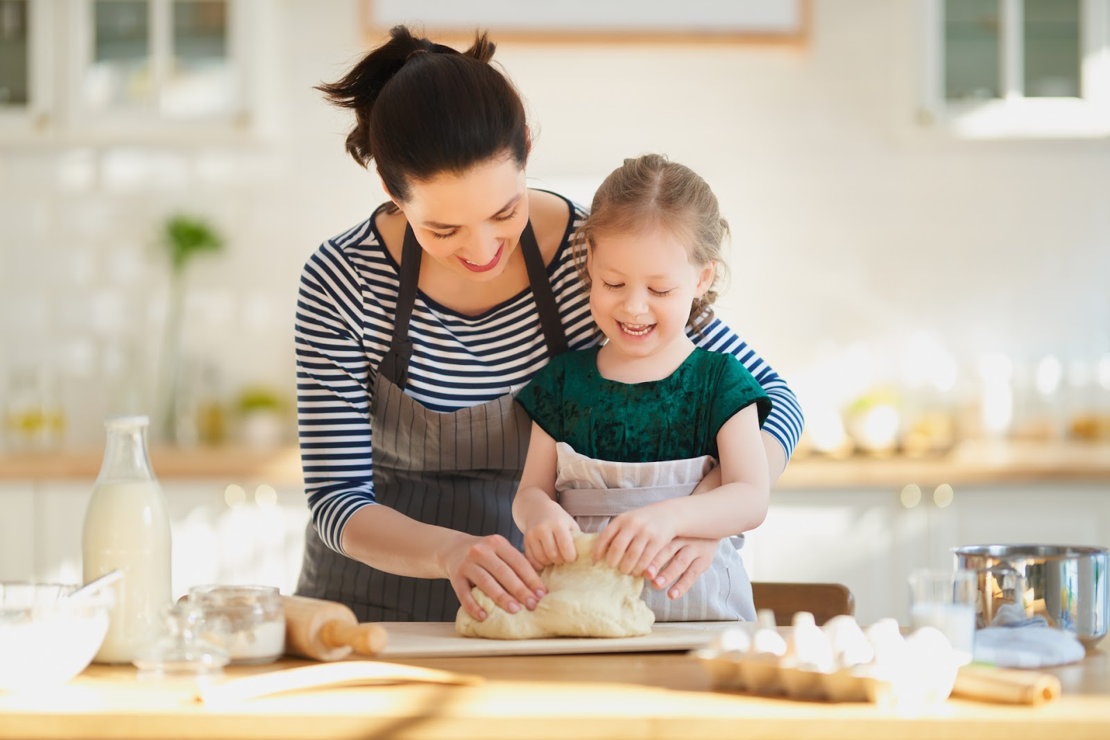 Mom and daughter baking together