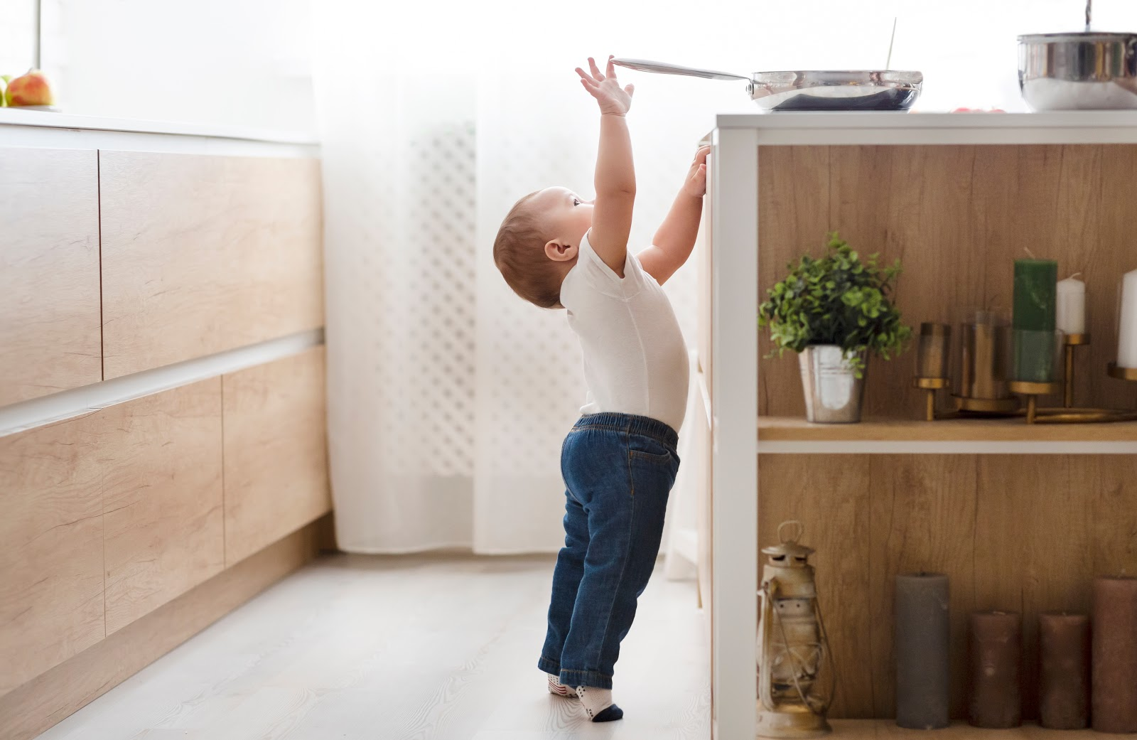 Toddler reaching for pan on the counter