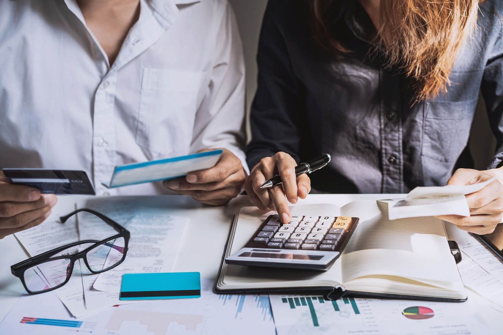 Man and woman calculating costs together