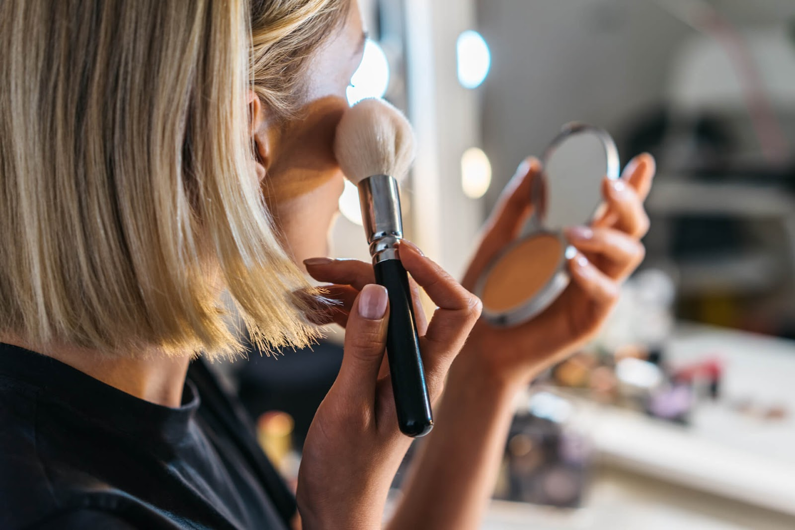 Woman putting on her own makeup
