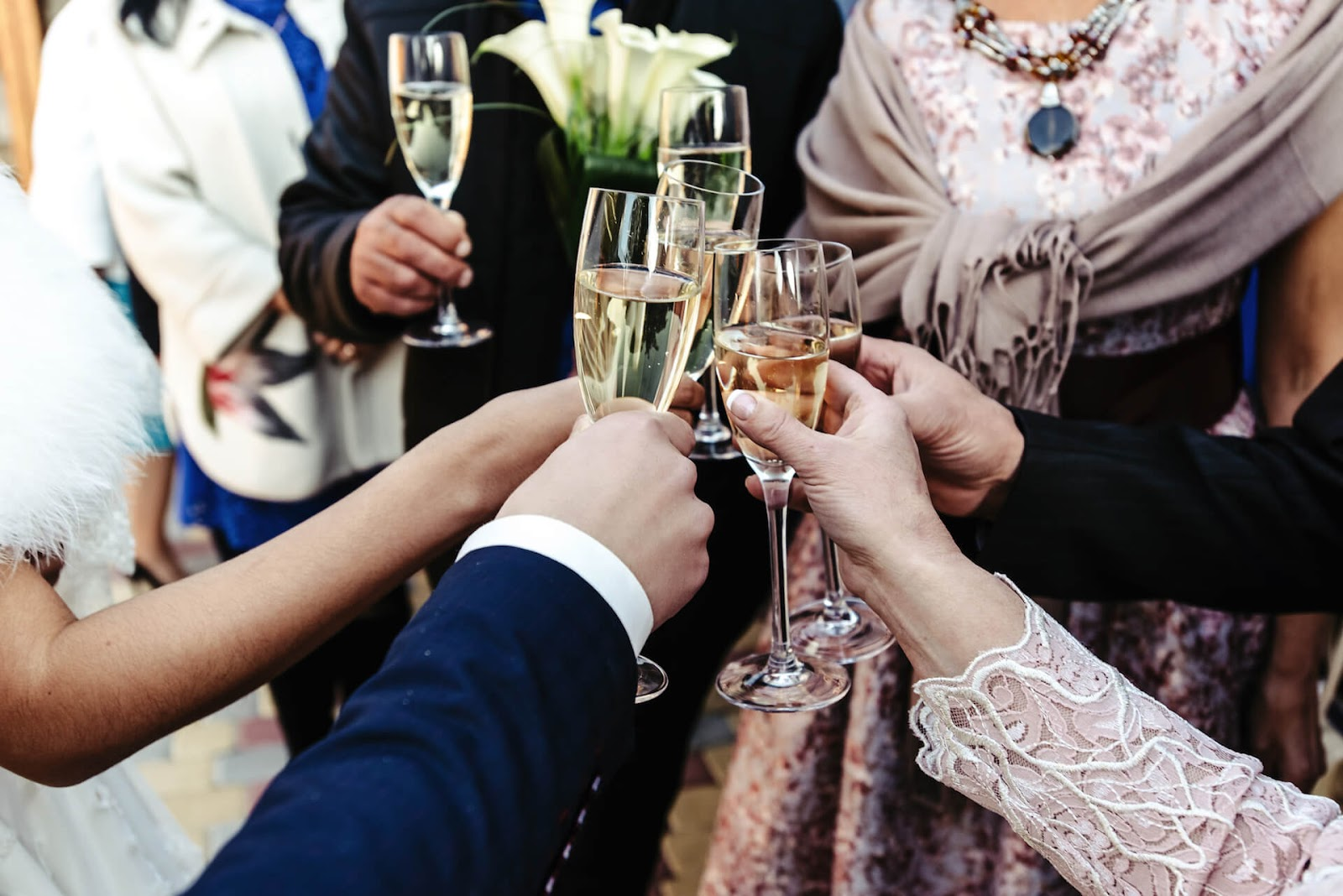 """Bridal party """"cheers"""" to the new couple"""