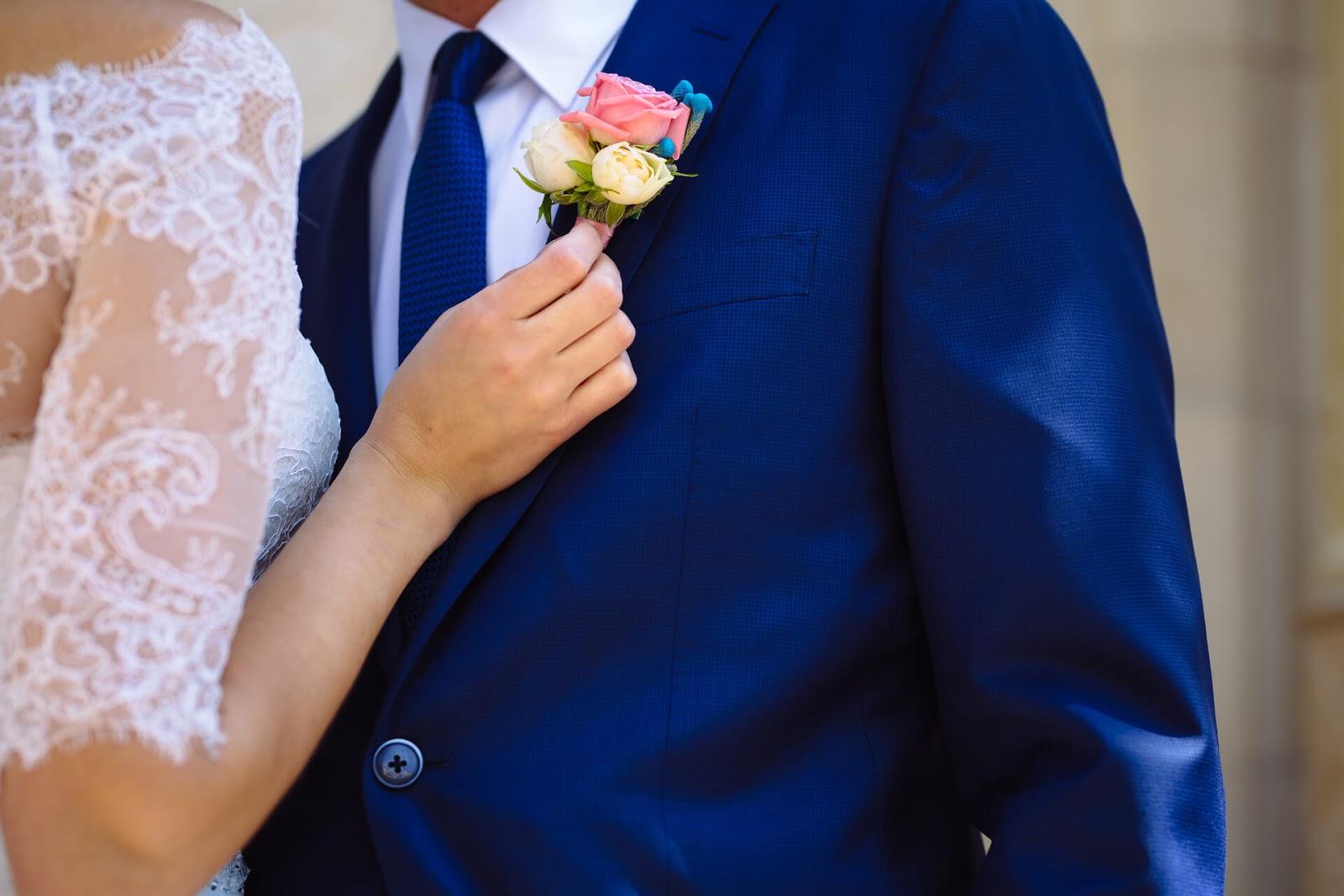 Woman straightening man's corsage