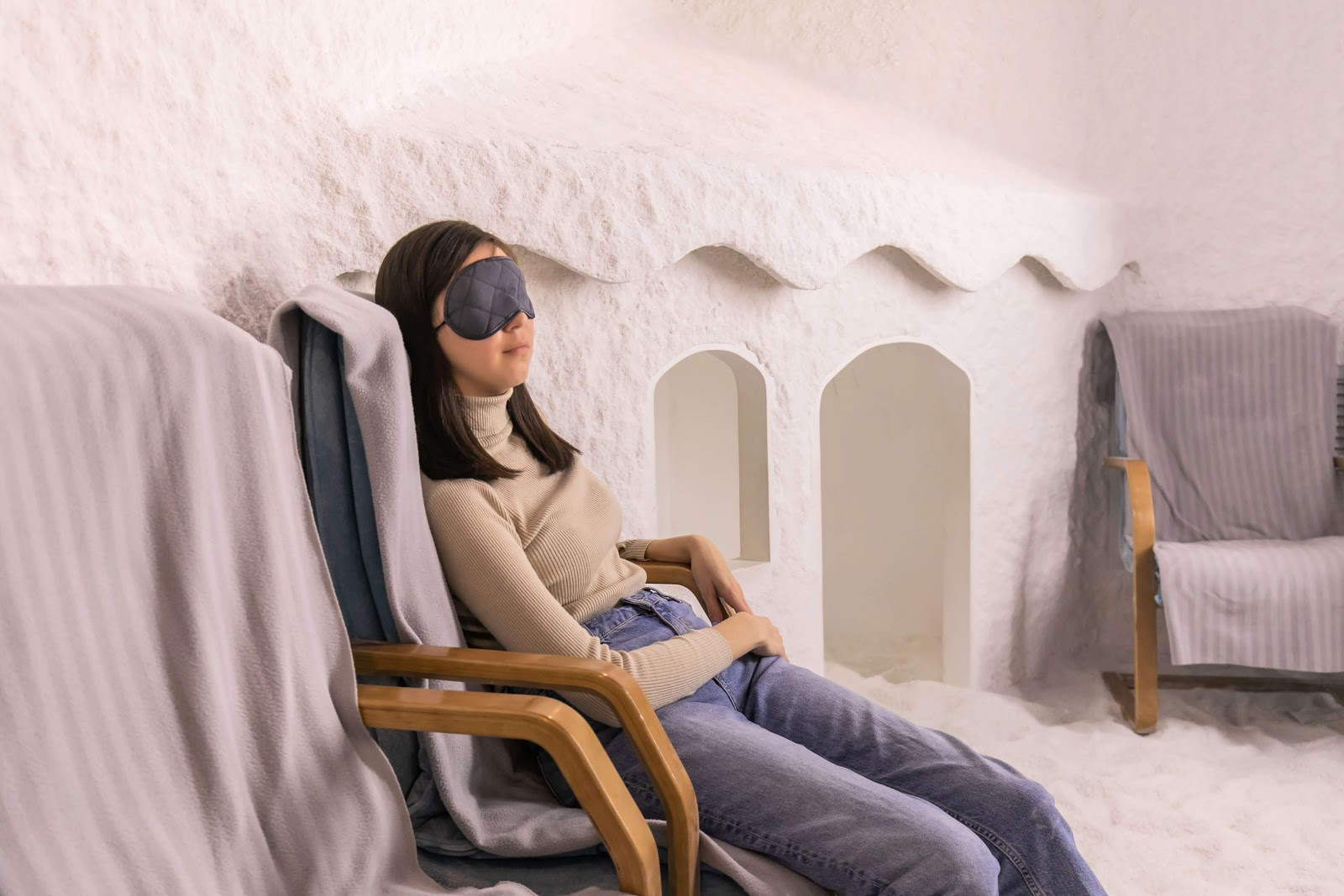 Woman sleeping with eye bask on in a salt room