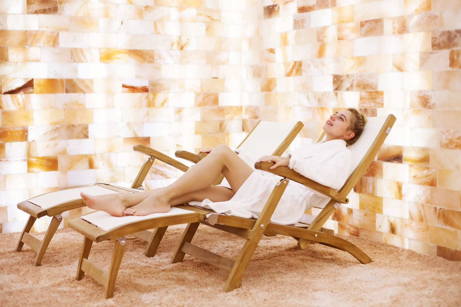 Woman sitting in lounger in a salt room