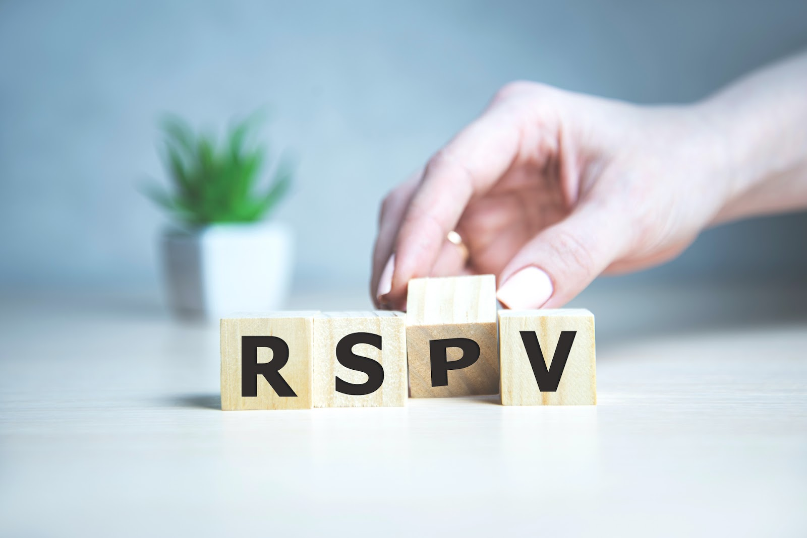 hand moving RSVP letters