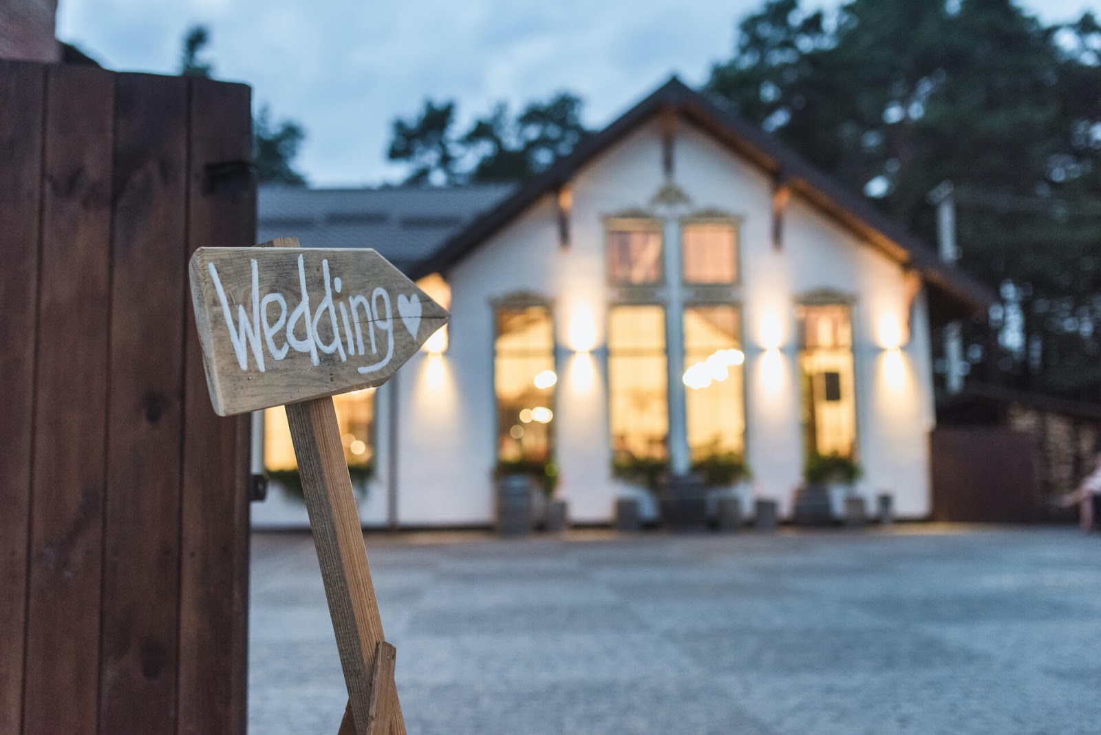 Wedding sign pointing to a building