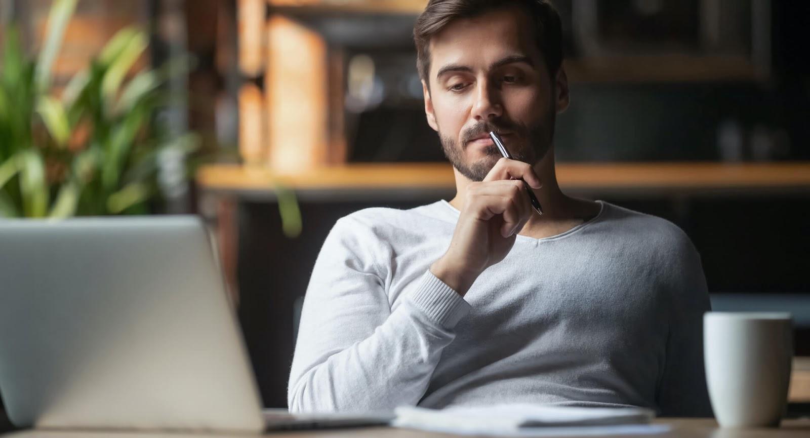 Man thinking at his desk