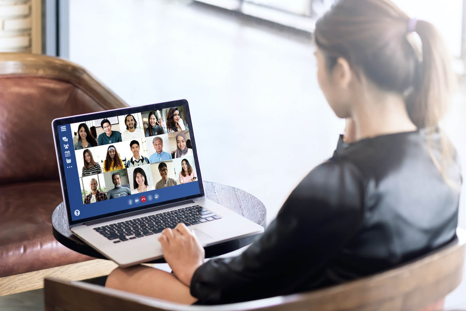 Woman in a zoom meeting with several people