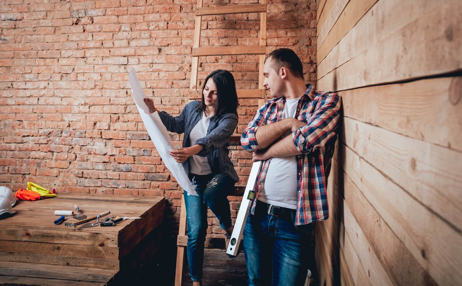 Couple looking at plans to build a tiny house