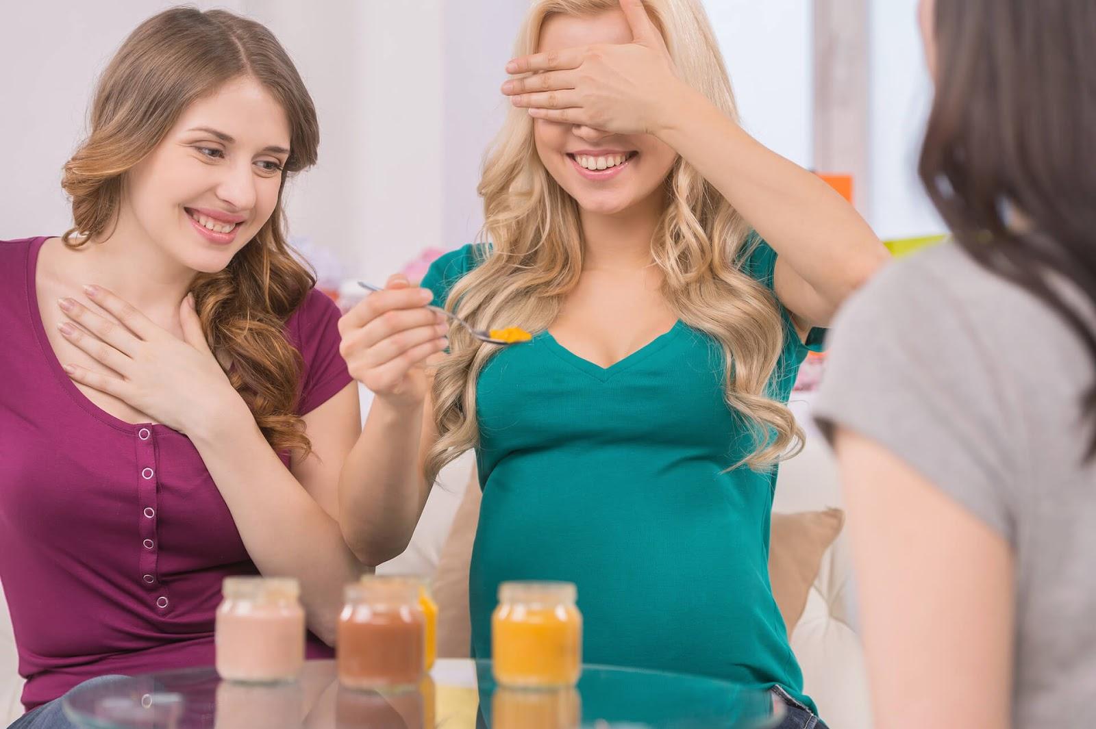 Ladies taste testing baby food