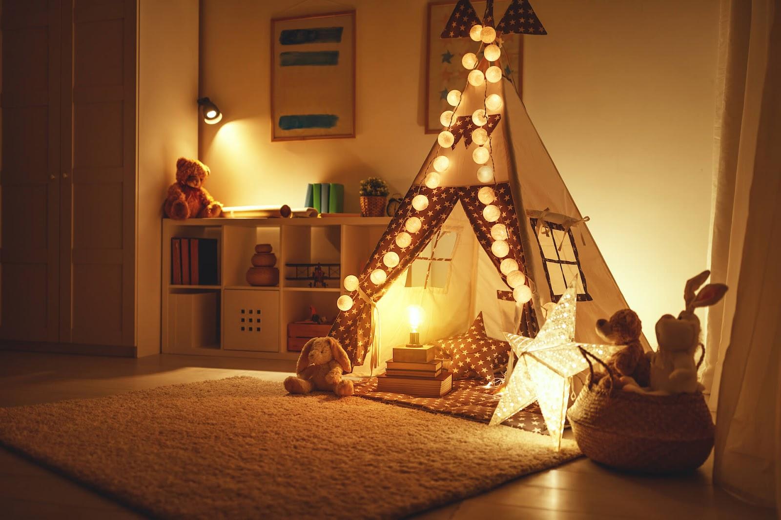 Child's room with night lights around teepee