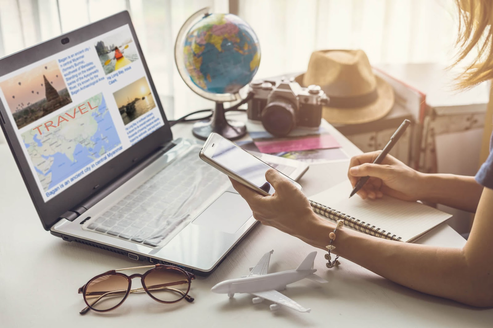 Woman planning a vacation with her frequent flyer perks