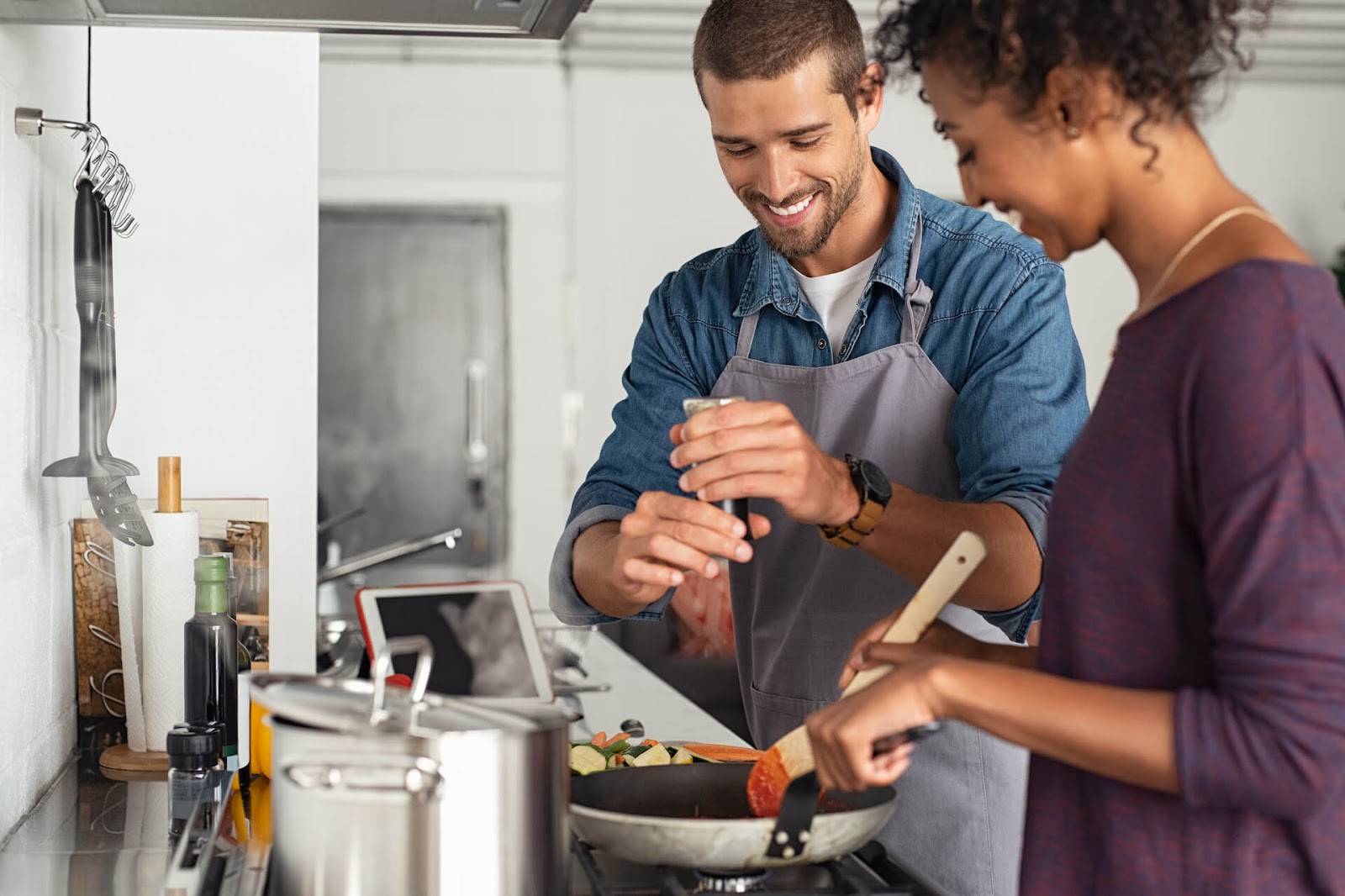 Man and woman cooking in the kitchen together