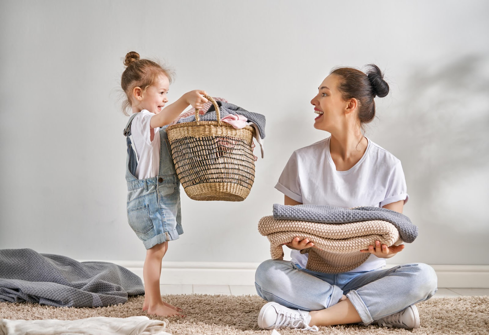 Mom enjoying laundry with her daughter