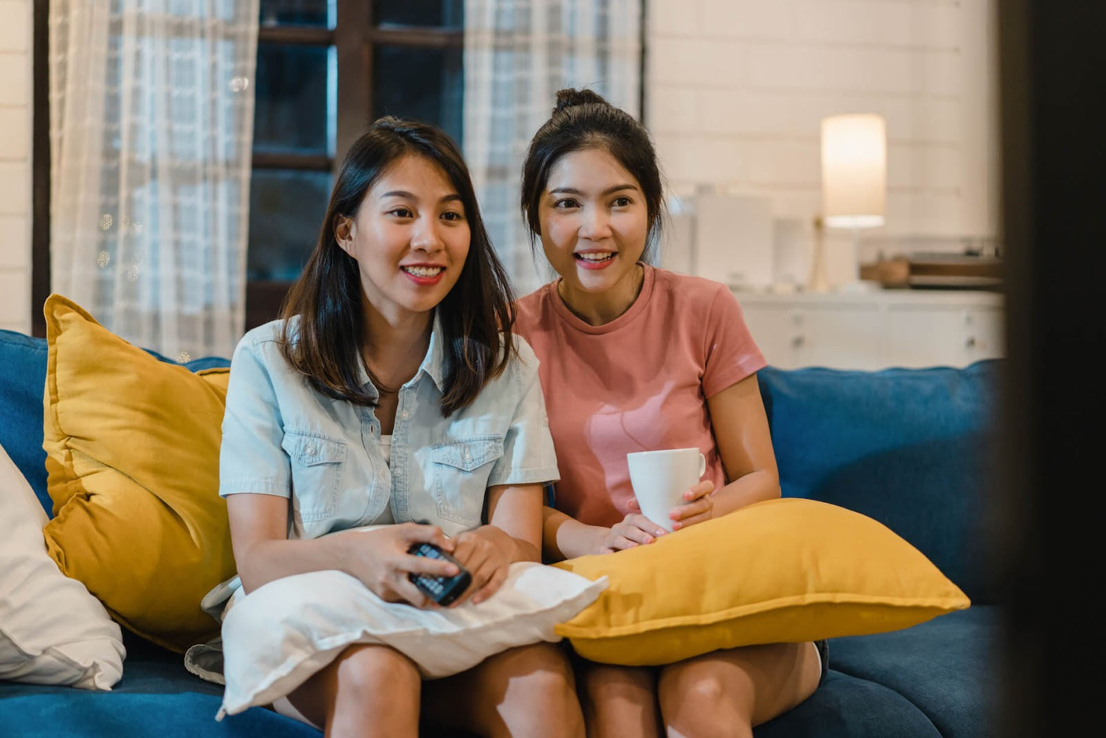 Two woman watching a movie together