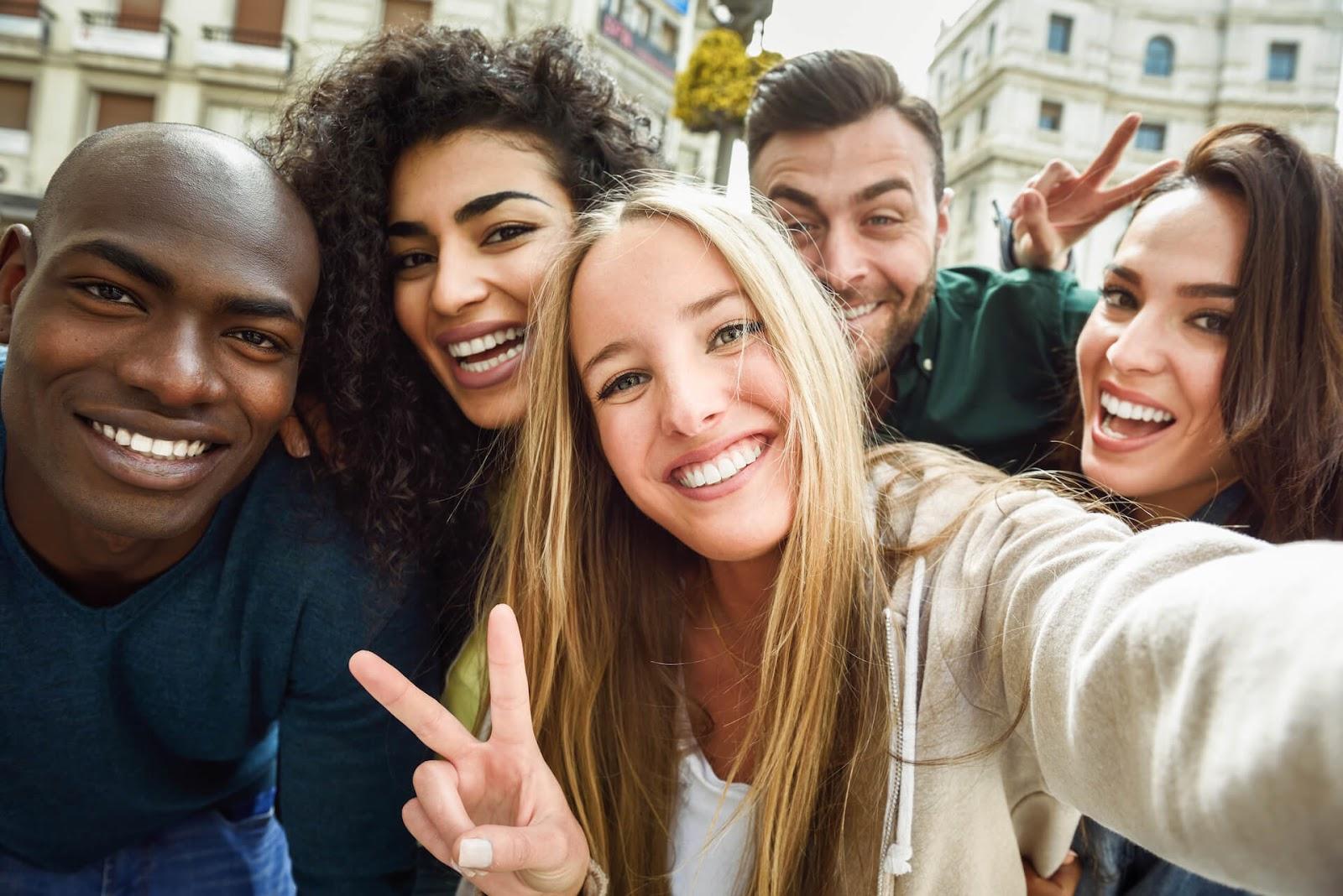 Friends taking selfie in town