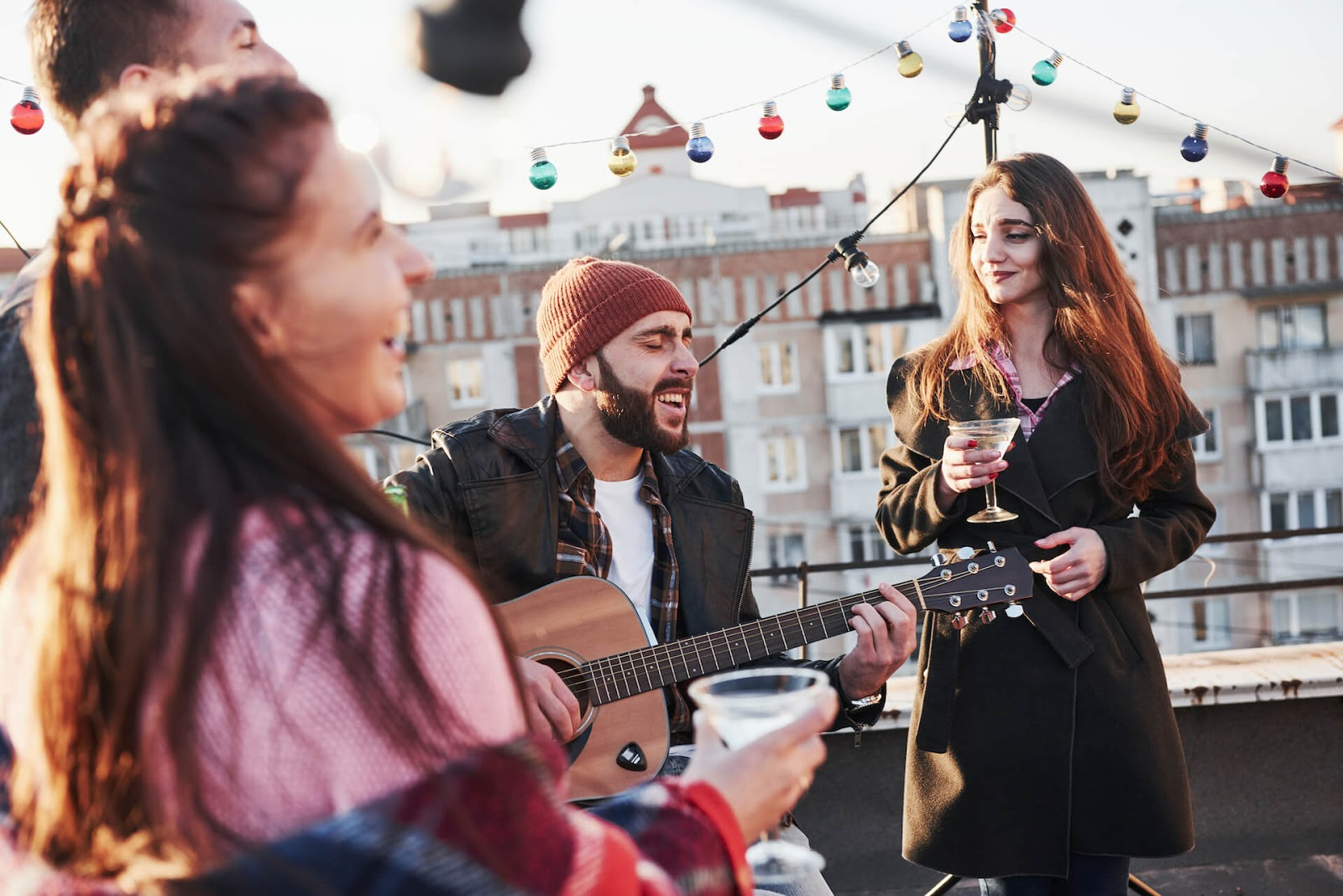 Friends playing music on a rooftop