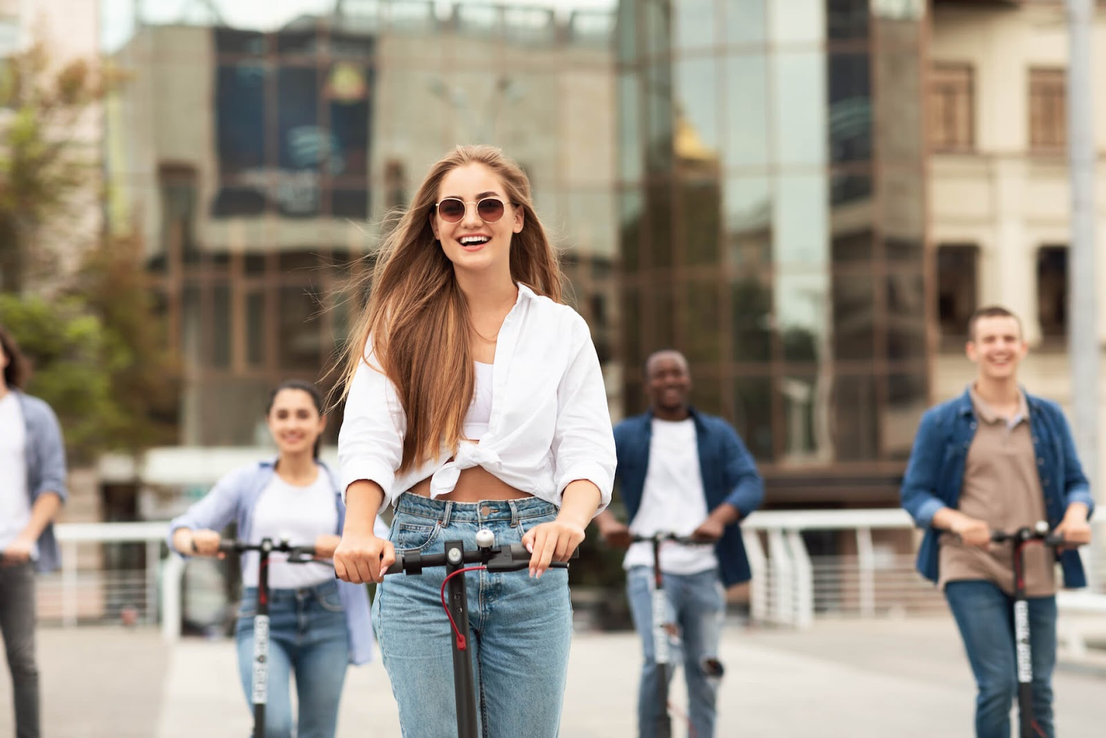 Woman scootering around a city with her friends