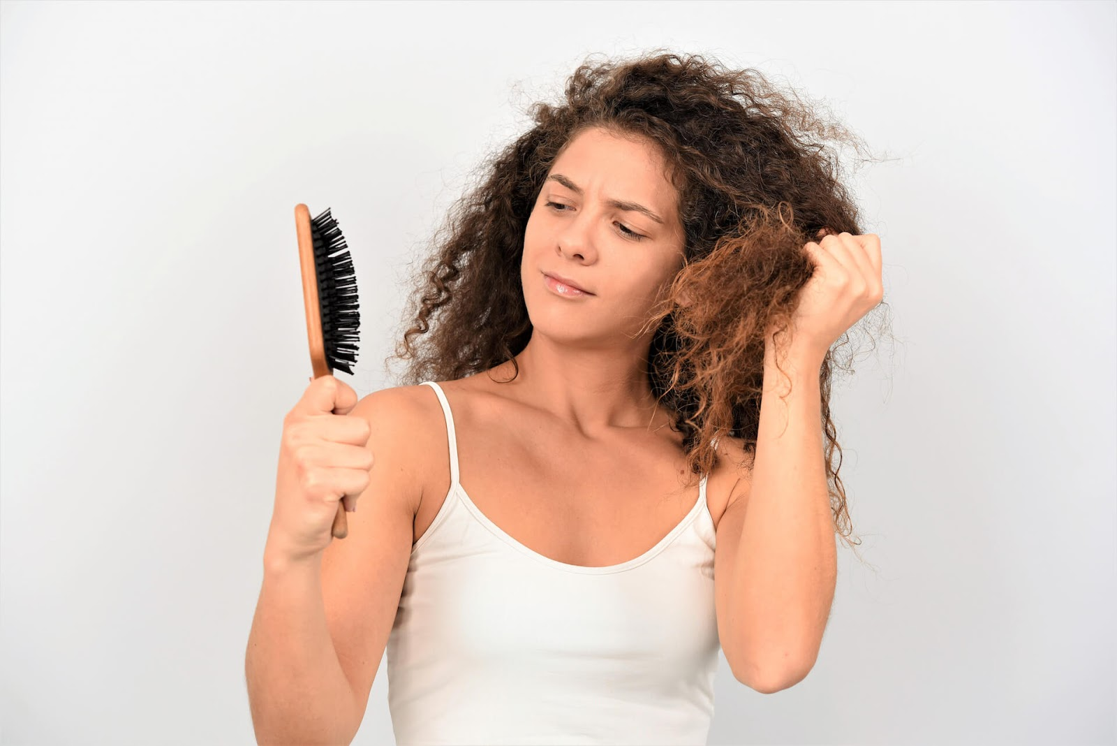 Woman looking at hair brush