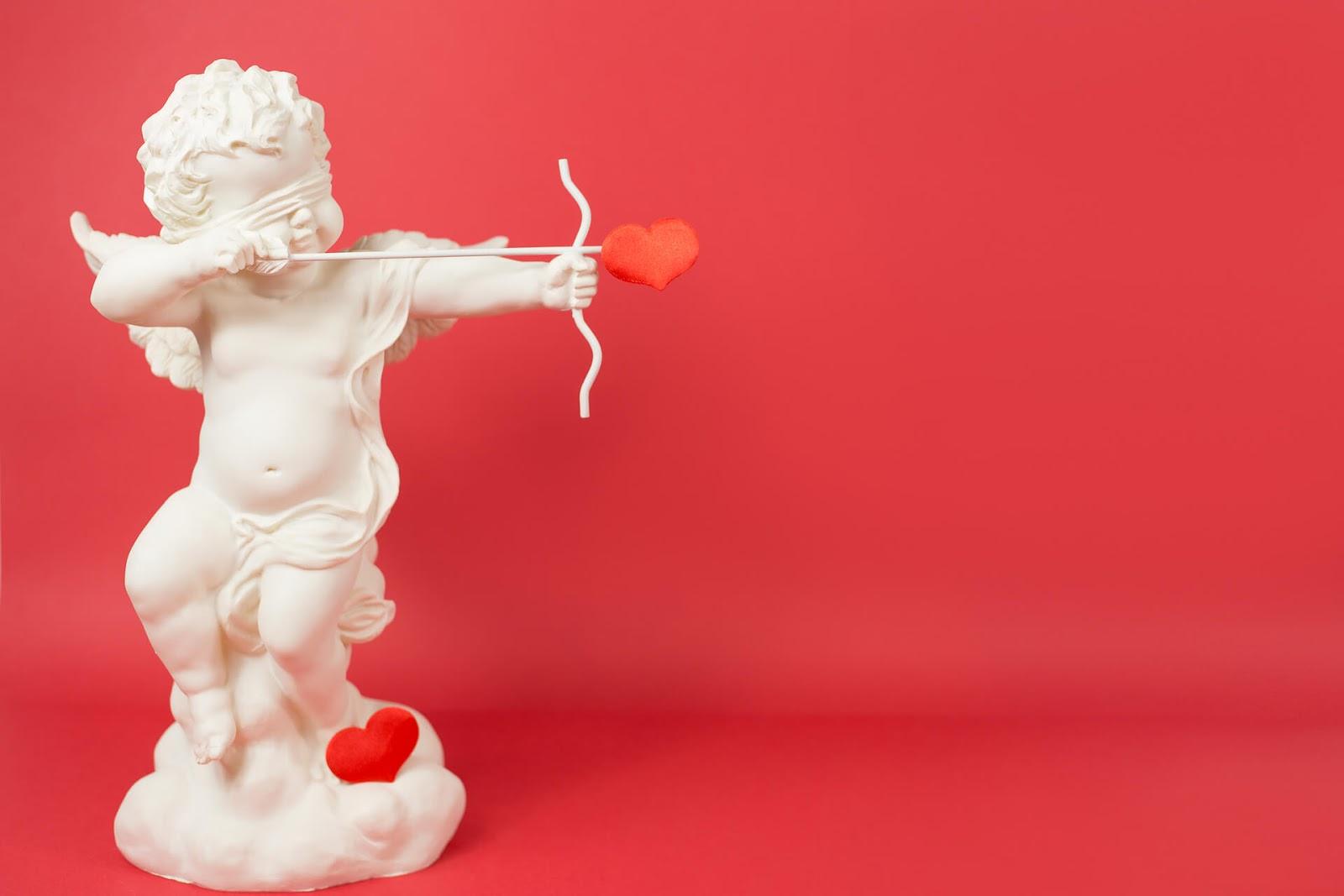 Cupid shooting his arrow blindly
