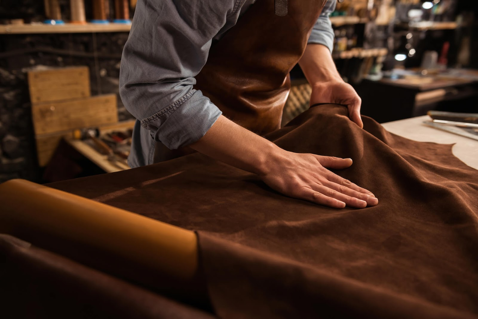 Man working with leather hides