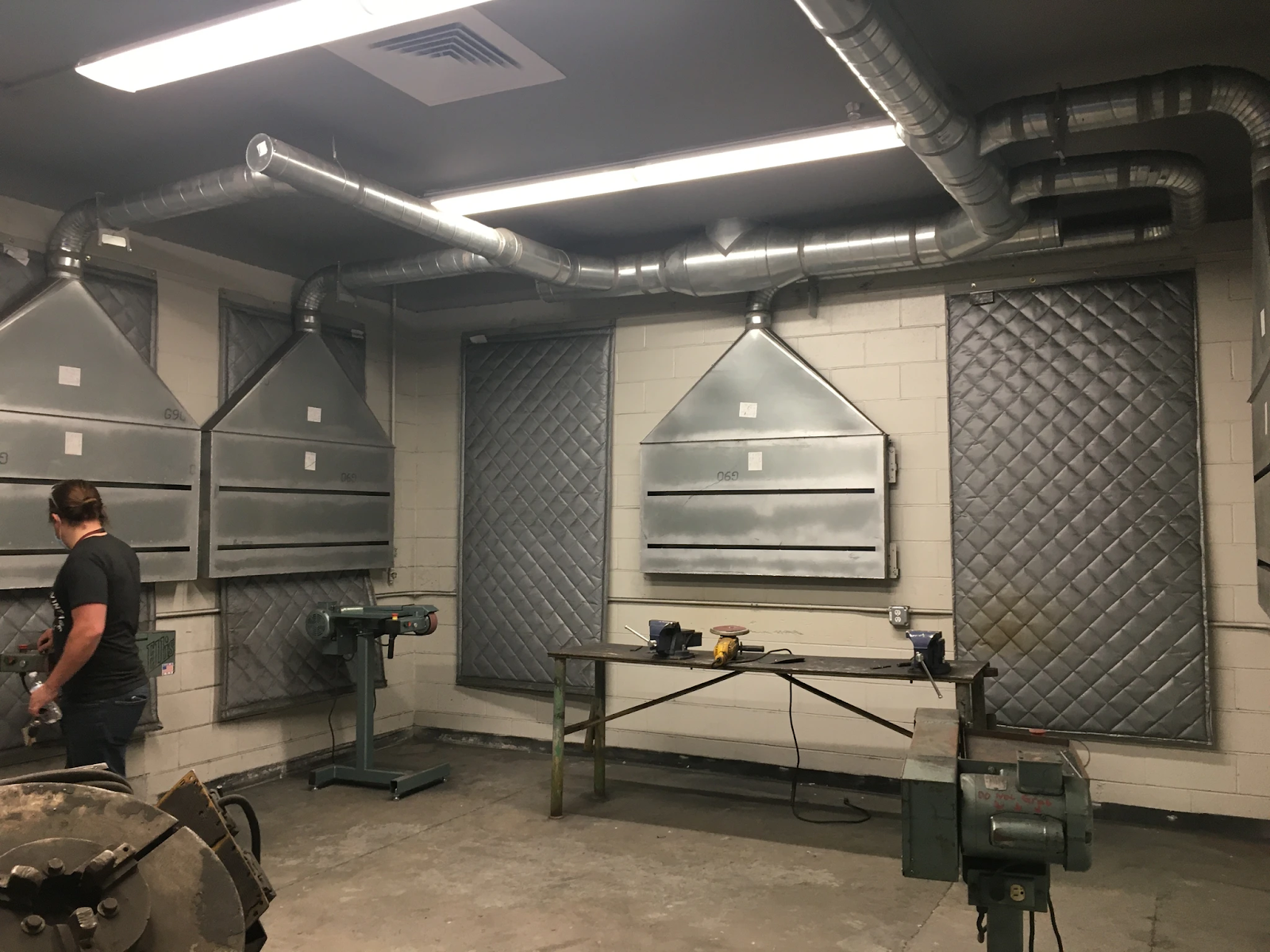 Garage with hanging acoustic blankets