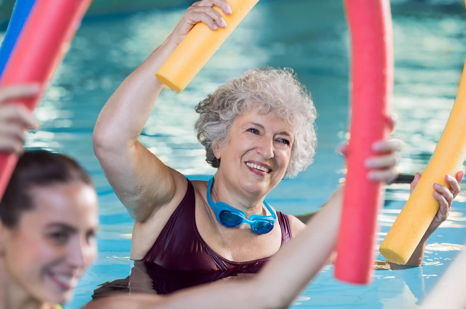 Woman enjoying water aerobics