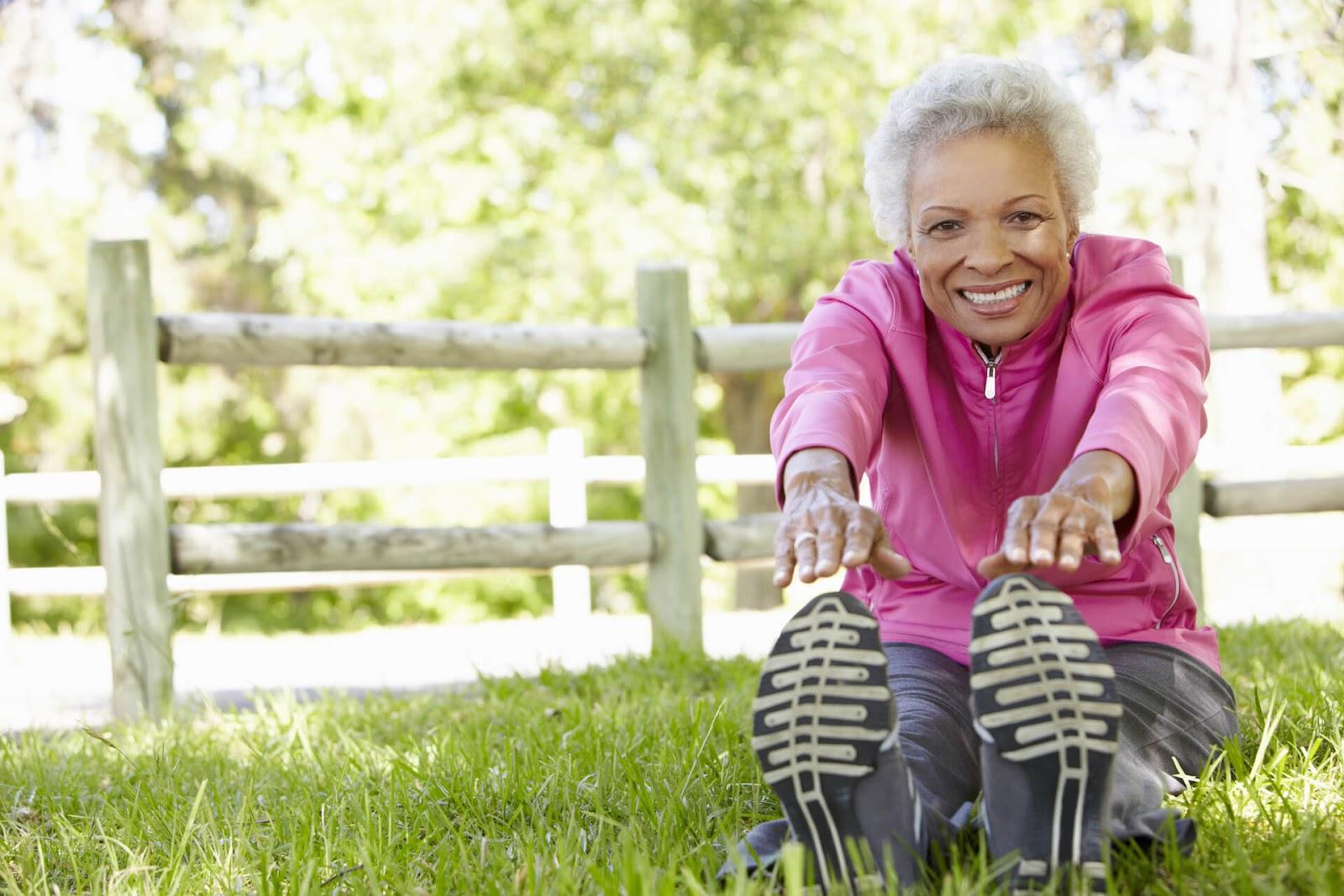 Senior Woman stretching outisde