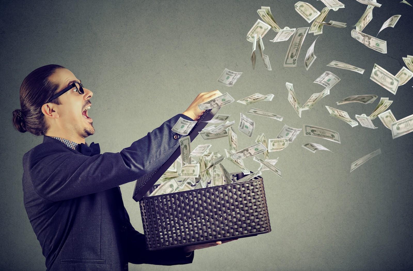 Man throwing money around