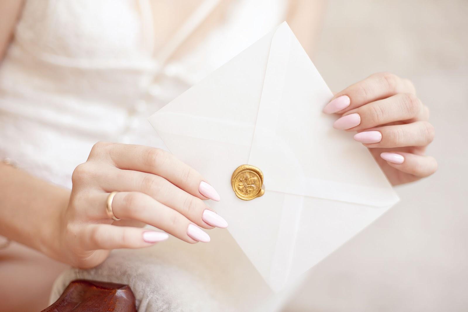 Hand holding an invitation