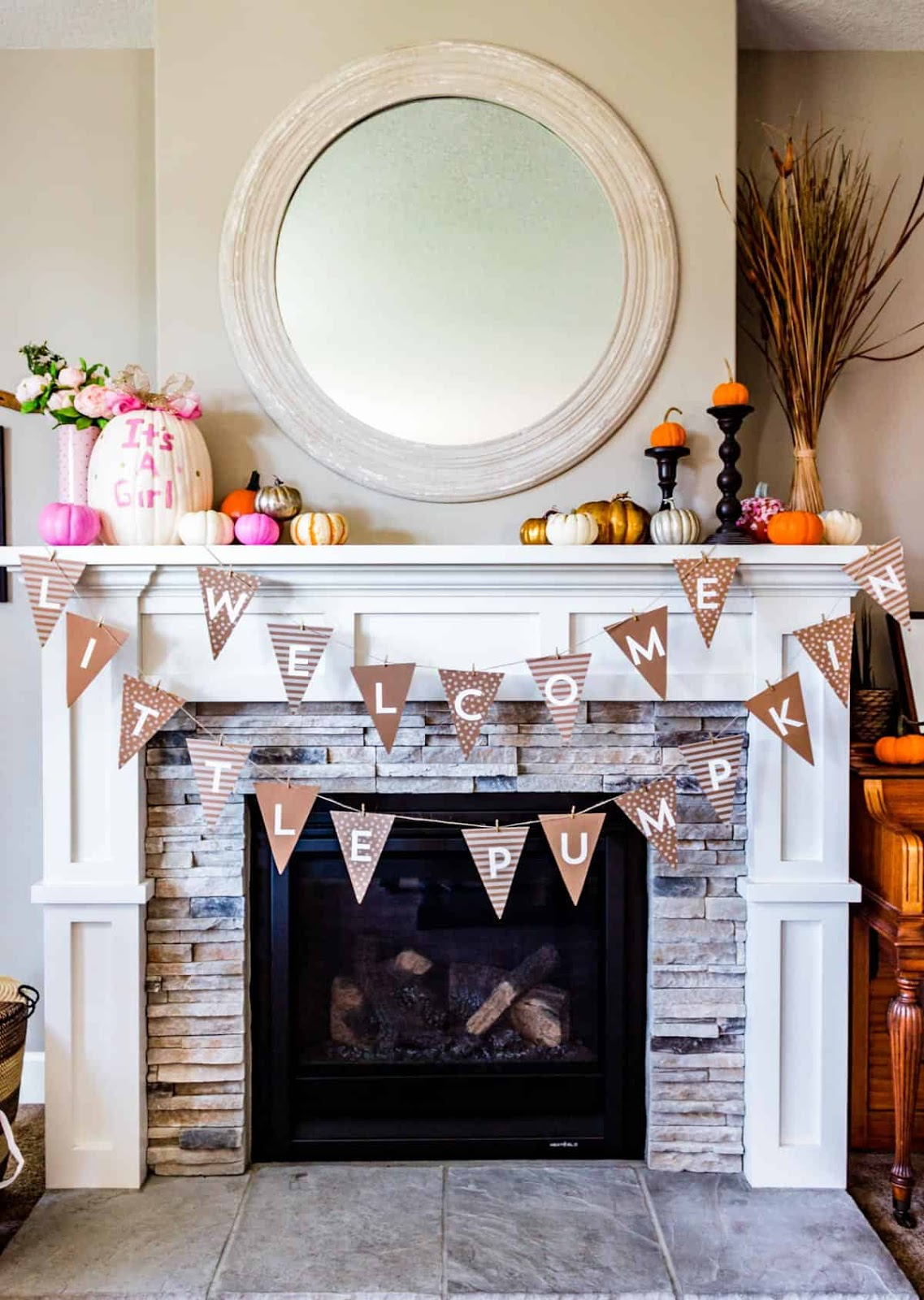 Pumpkin themed baby shower banner over the mantle