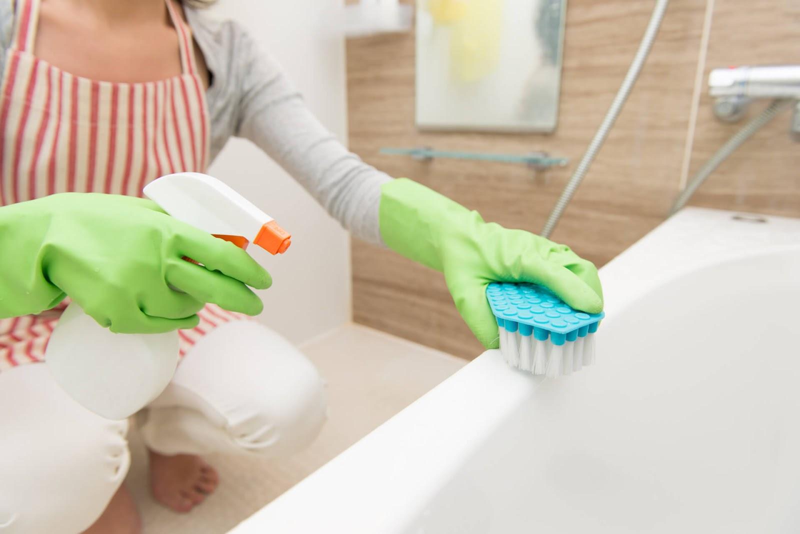 Woman scrubbing her bathtub