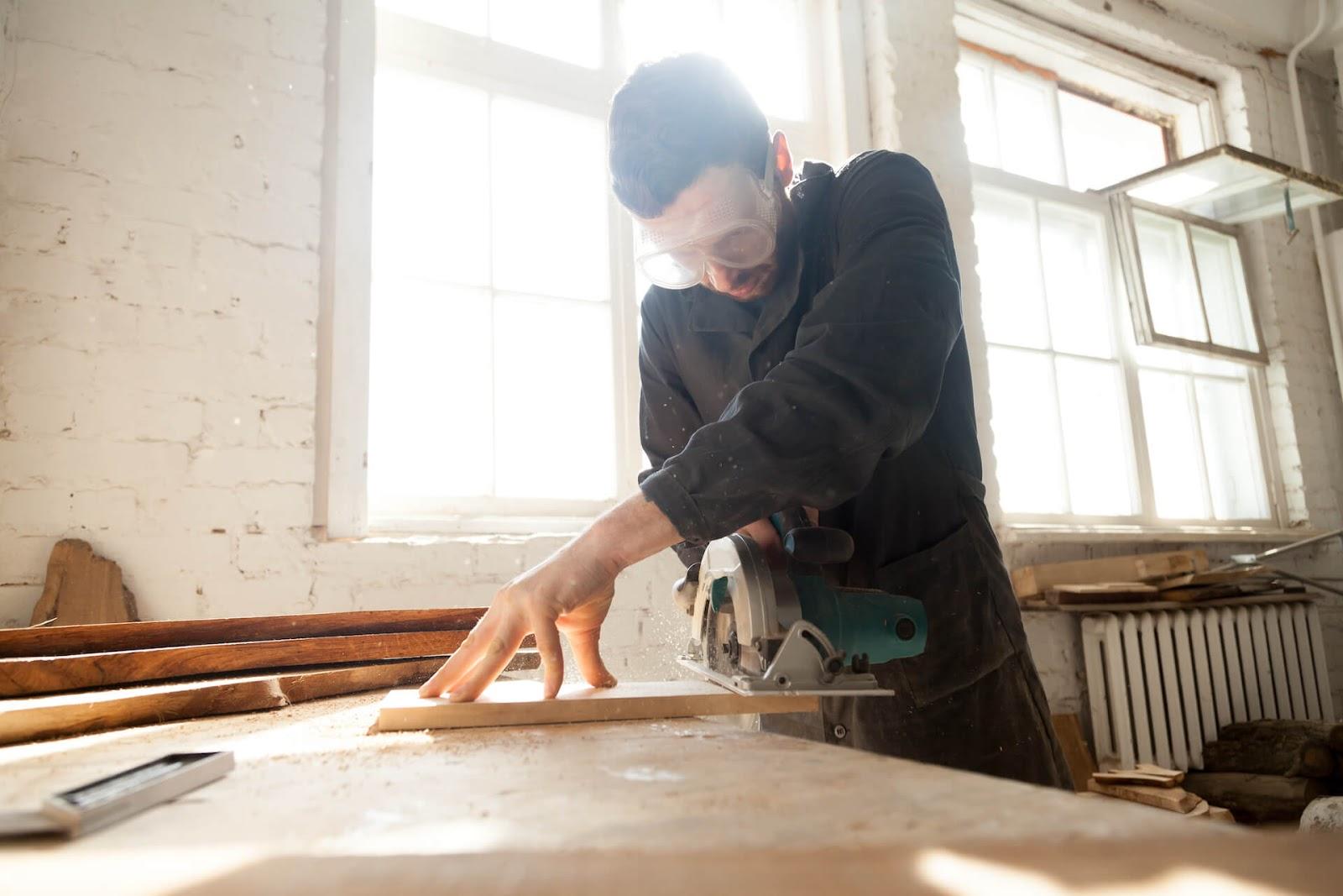 Man cutting cabinets