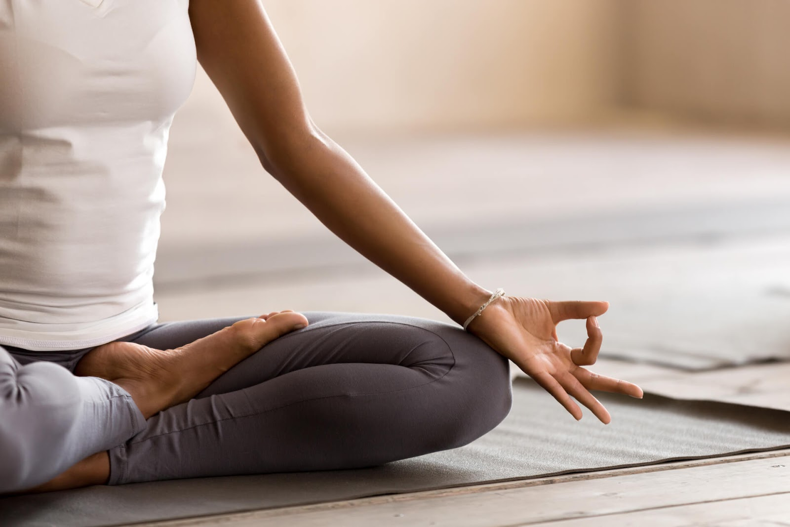 Close up of woman meditating on the floor