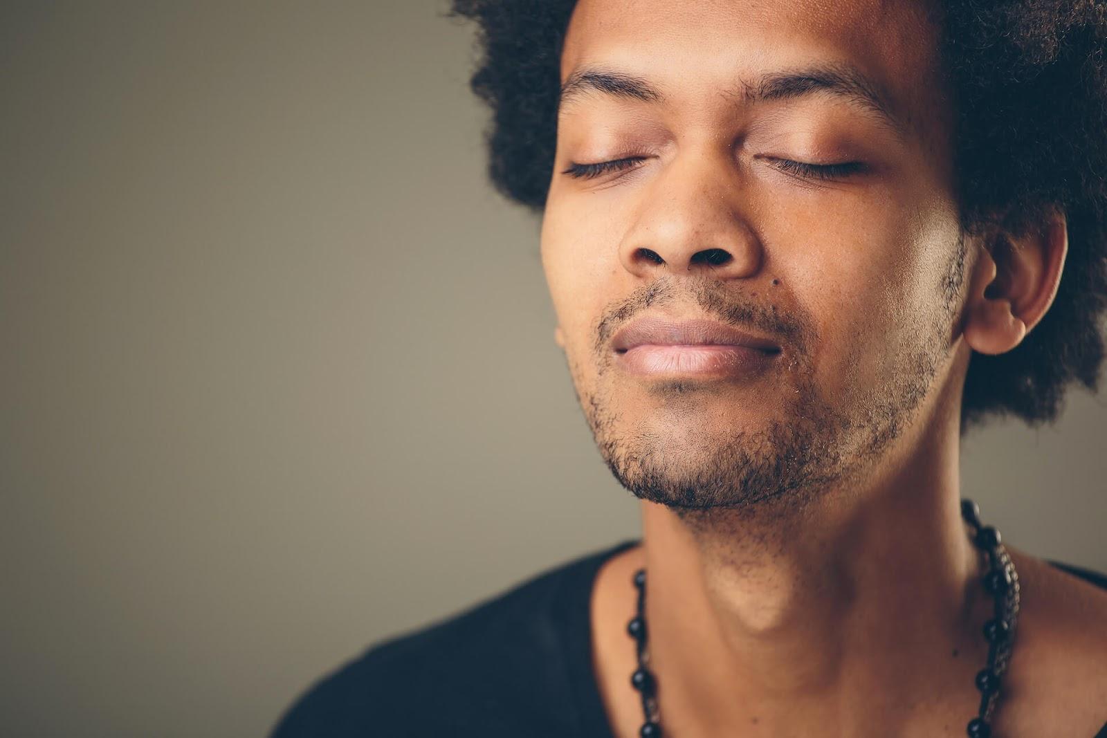 Man inhaling peacefully