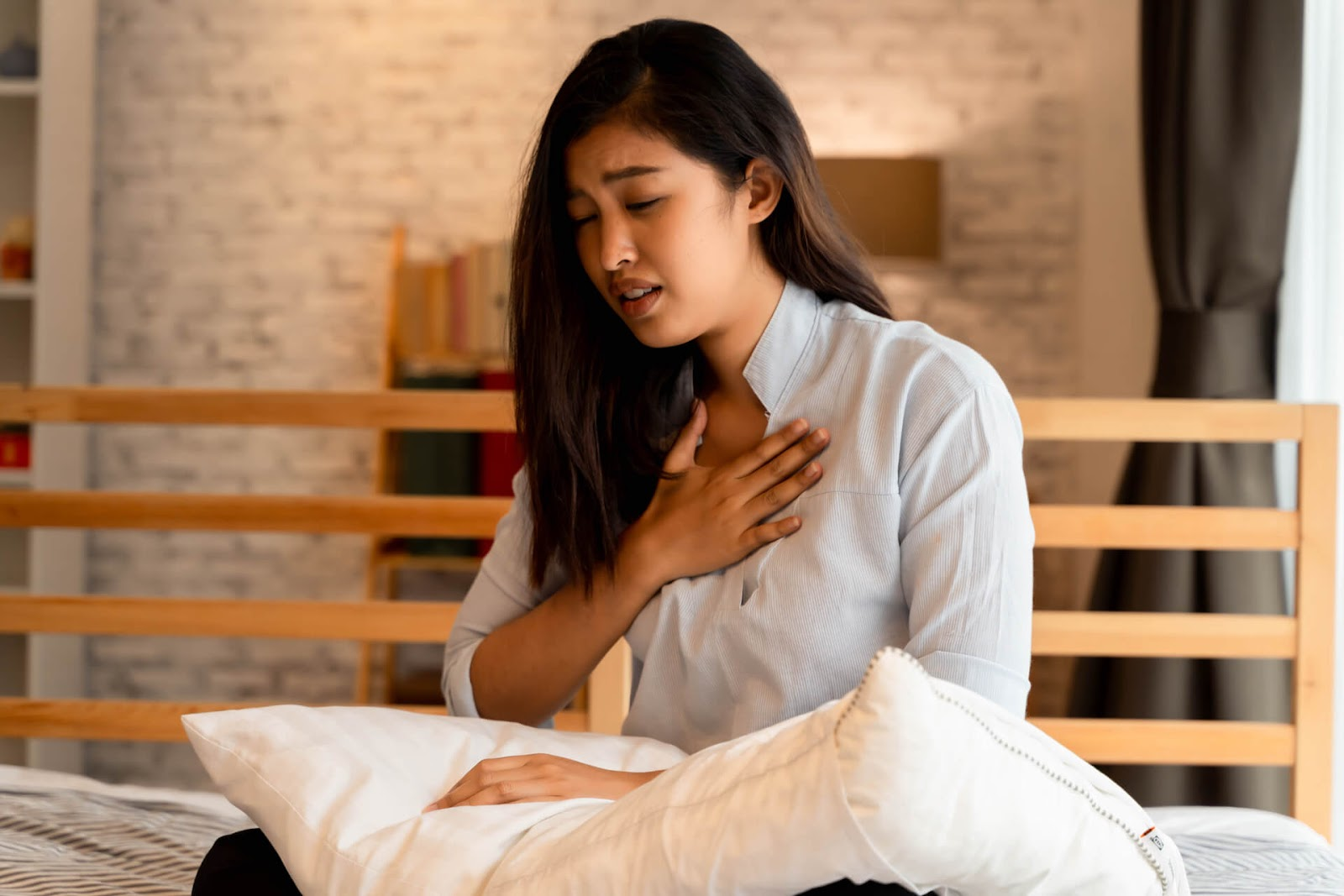 Woman holding her chest to catch her breath