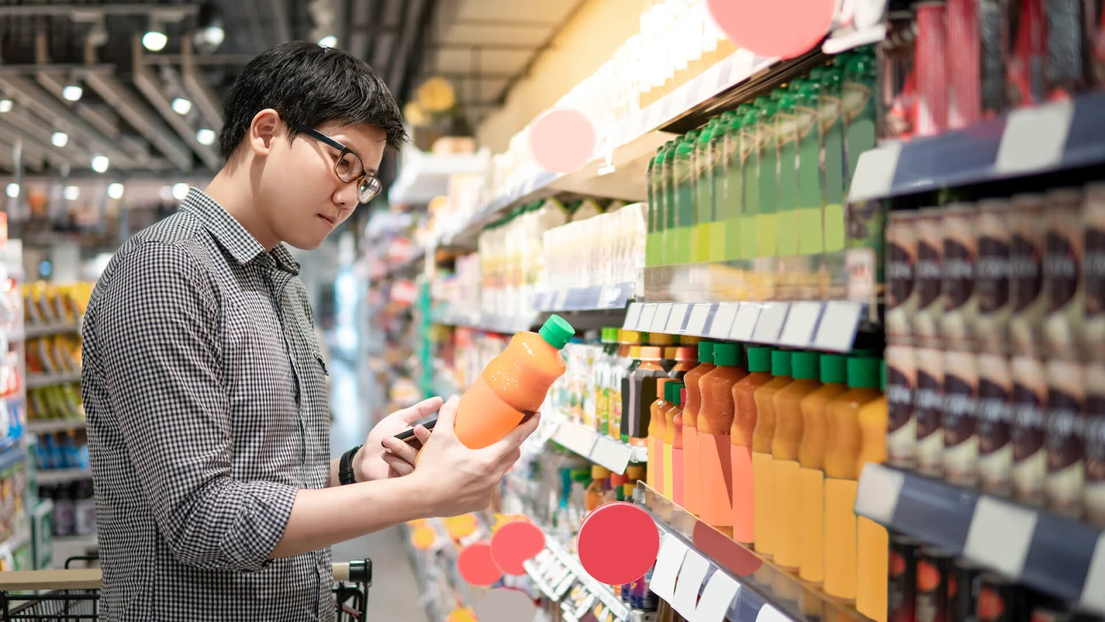 Man looking at the nutrition label on a juice bottle