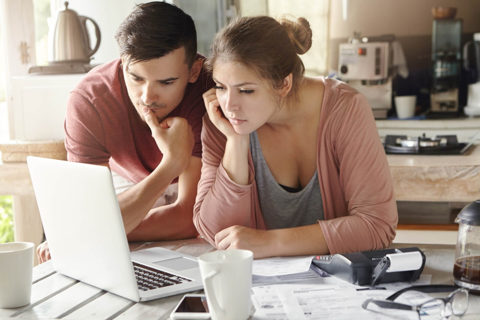 Man and woman looking over their finances together