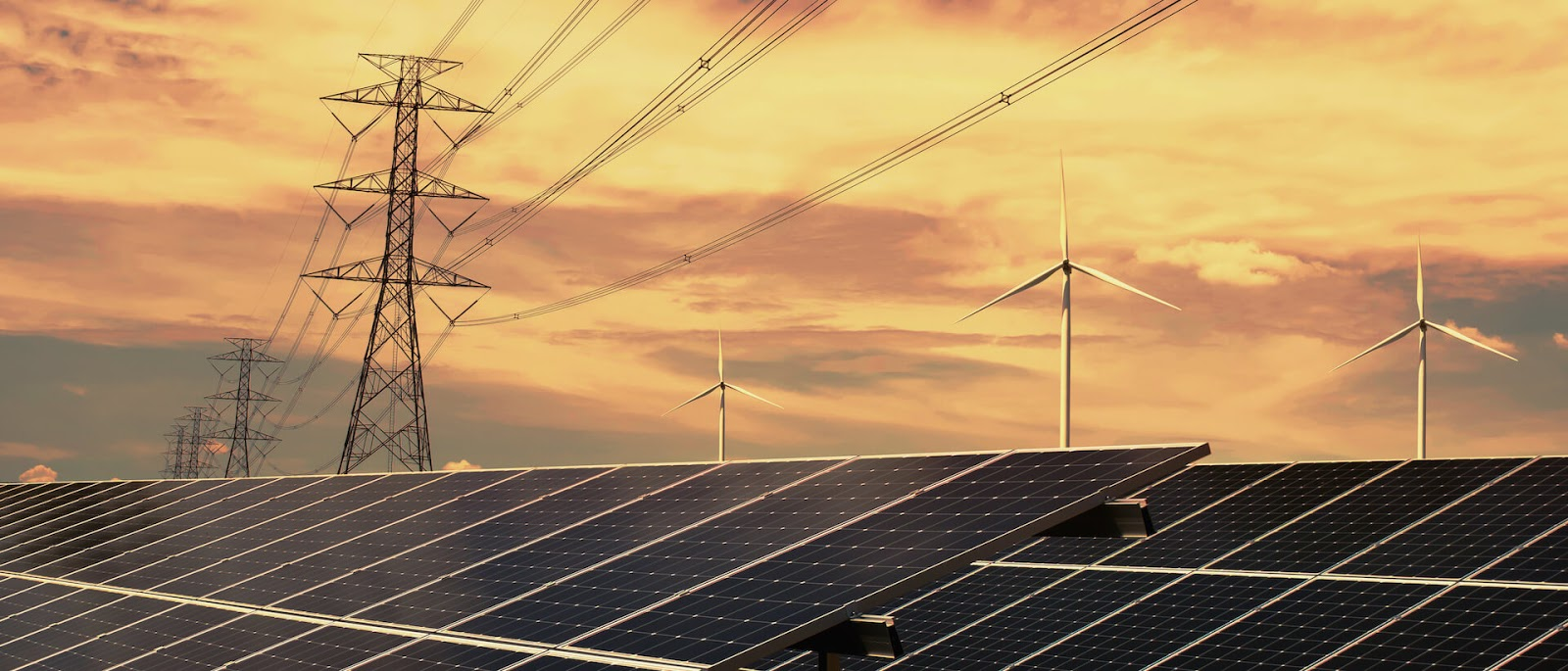 Sunset view of solar panels, electricity lines and windmills