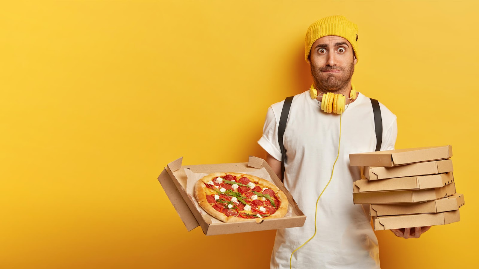 Man holding boxes of pizza